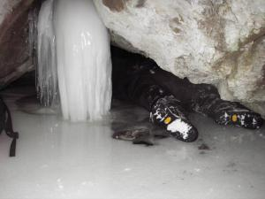WNS researcher squeezing into cave in search of bats and fungus - Photo credit: Karen Vanderwolf